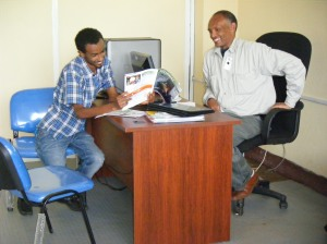 Tilahun Gebey, Director (right) andAmmanuel Mengiste , Coordinator, in the office of Bees for Development Ethiopia in Bahir Dar. Bees for Development Ethiopia has been registered in Ethiopia as a local charity and is governed by 5 Board Members.